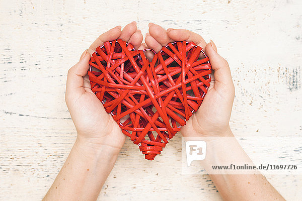 Hands of woman holding handmade valentine