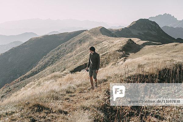 Caucasian man hiking on mountain