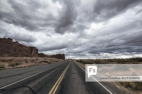 Street in desert under clouds