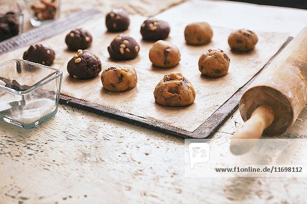 Cookie dough on baking sheet near rolling pin