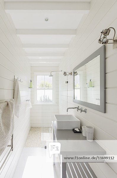Long  sunny white modern luxury bathroom