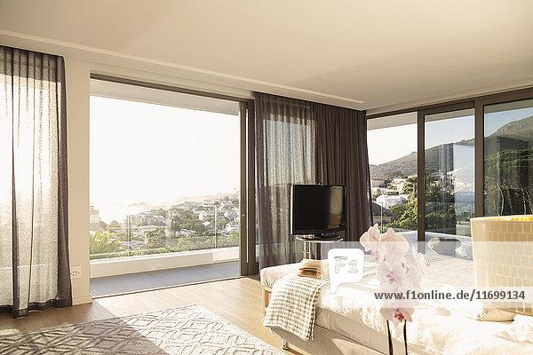 Sunny modern luxury home showcase bedroom