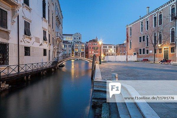 Night falls in the sestier of Dorsoduro  Venice  Italy.