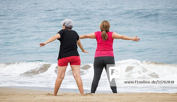 A group of elderly local women at their daily exercise class on Las Canteras beach in Las Palmas  Gran Canaria  Canary Islands  Spain.
