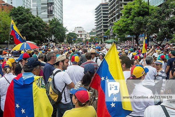 People march in protest against the government of Nicolás Maduro in the streets of Caracas on May 1 2017.