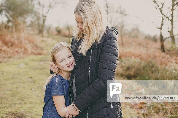 Girl cuddling her mother