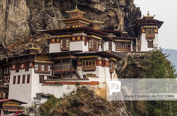 The Tiger's Nest Monastery  or Taktsang Goemba  is a Himalayan Bhuddist monastery perched on sheer cliffs 900 meters above the floor of the Paro Valley in Bhutan. It is at 3 120 meters or 10 240 feet elevation.