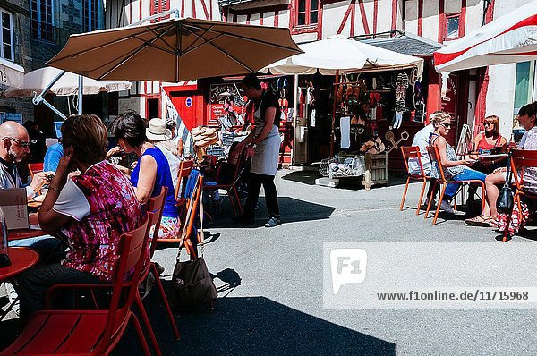 Tourists having lunch at typical restaurant terrace. Vannes  Brittany  France.