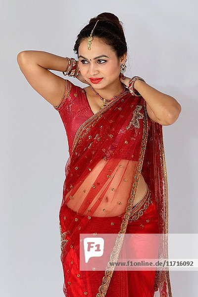 Young Indian girl in red traditional sari.