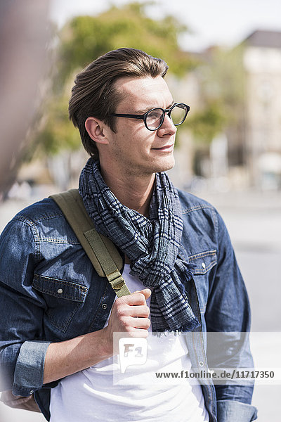 Portrait of confident young man outdoors