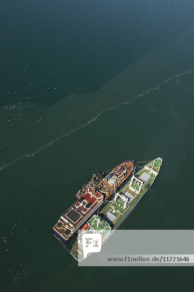 'Aerial of a pair of floating commercial fishery processing facilities rest at anchor in the Bristol Bay region near Togiak  Southwest Alaska  USA'