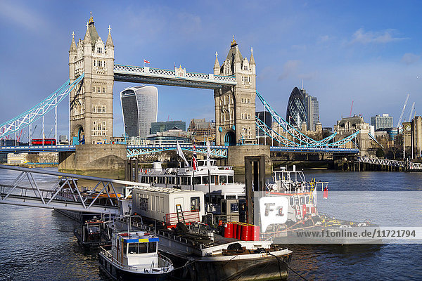 'Tower bridge and boats in the River Thames; London  England'
