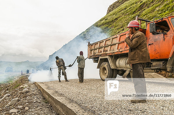 'Chinese workers making a road; Daocheng  Sichuan province  China'