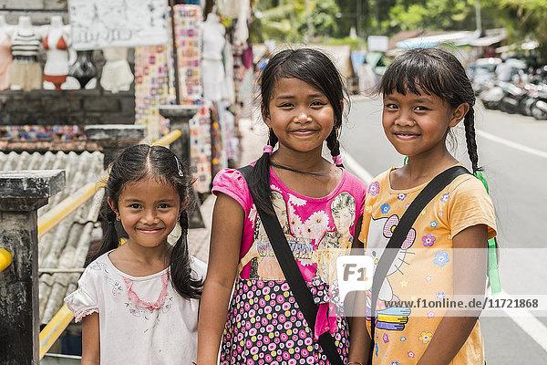 'Portrait of three young girls; Tegallalong  Bali Island  Indonesia'