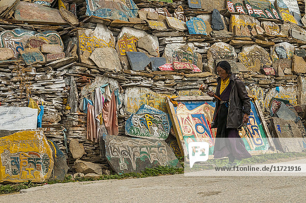 'Litang Monastery  in the entrance near to the Stupa  many stones carved with the symbols of the mantra ''Om Mani Padme Hum''  West of Sichuan province; Litang  Sichuan  China'
