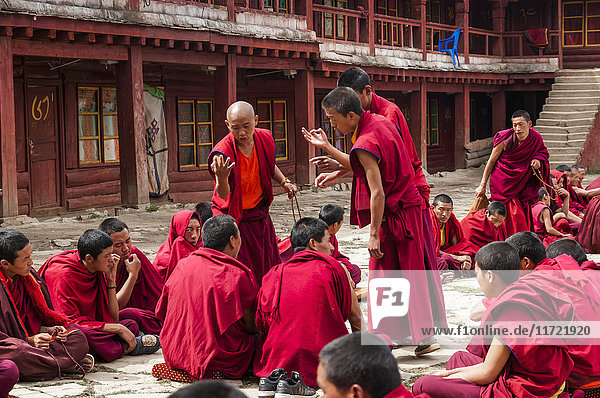 'Litang Monastery  the main temple where the young buddhist monks are preparing a Tibetan debate; Litang  Sichuan  China'