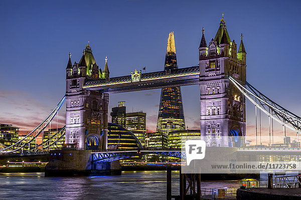 'Shard with Tower Bridge at sunset; London  England'