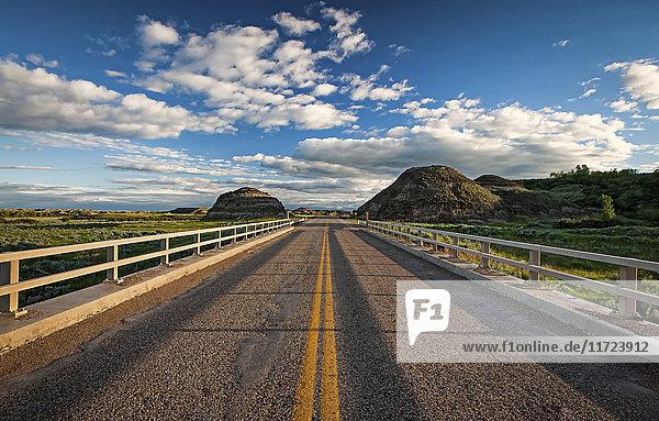 'Double solid yellow line down a paved road; Herschel  Saskatchewan  Canada'