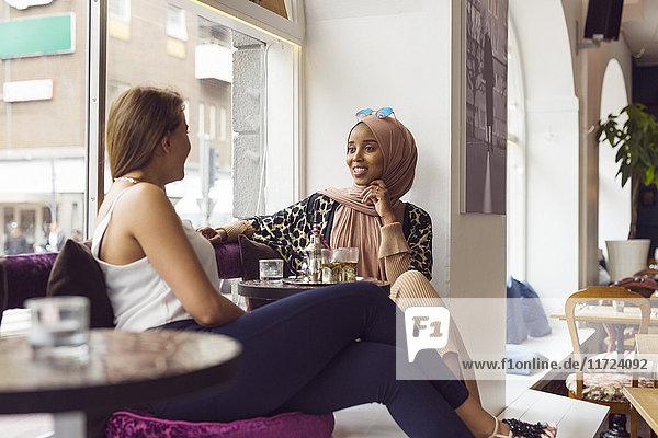 Businesswomen talking in tea room