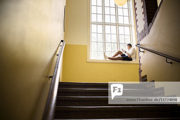 Student (14-15) sitting by window