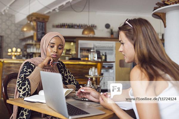 Businesswomen working in tea room Businesswomen working in tea room