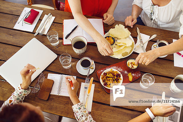 Businesswomen during lunch in restaurant