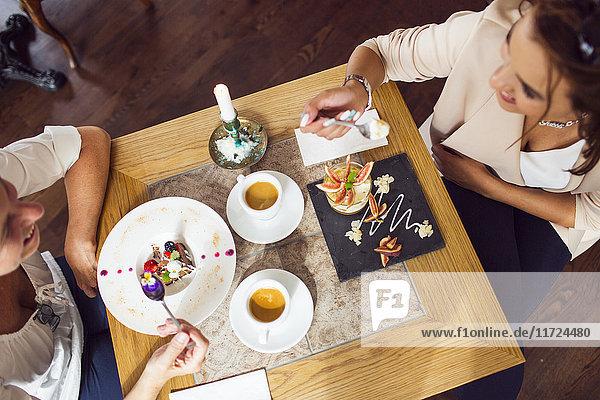 Businesswomen eating dessert in restaurant Businesswomen eating dessert in restaurant