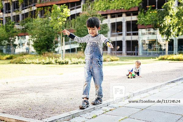 Boys (2-3  4-5) playing at playground Boys (2-3, 4-5) playing at playground
