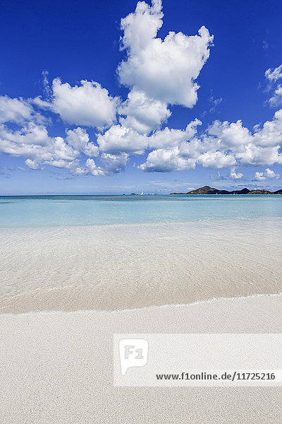 Blue sky frames the white sand and the turquoise Caribbean sea Ffryers Beach Antigua and Barbuda Leeward Islands West Indies