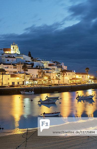 The traditional fishing village of Ferragudo at dusk. Algarve  Portugal