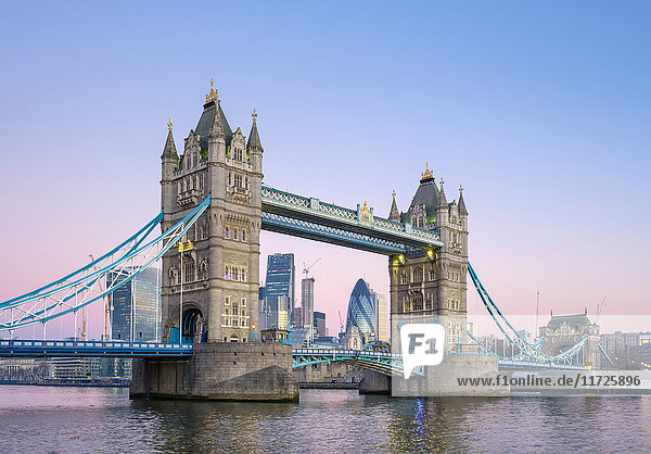 United Kingdom  England  London. Tower Bridge over the River Thames and skyline of central London at dawn.