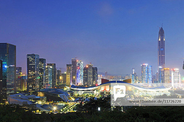 Shenzhen cityscape at dusk with the Civic Center and the Ping An IFC on foreground  China