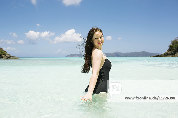 USA  Virgin Islands  Saint Thomas  Beautiful woman standing in ocean