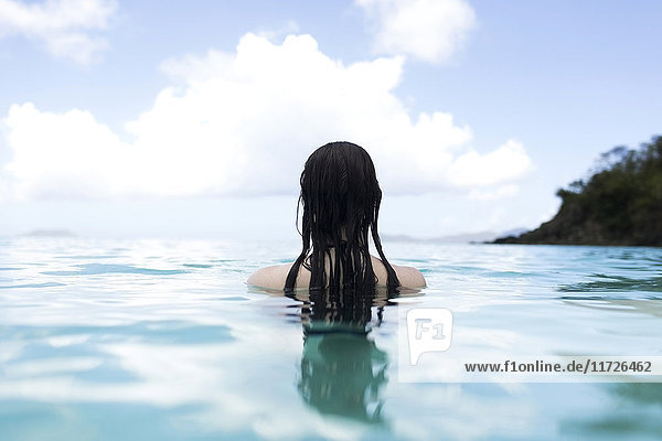 USA  Virgin Islands  Saint Thomas  Woman with long hair standing in bay