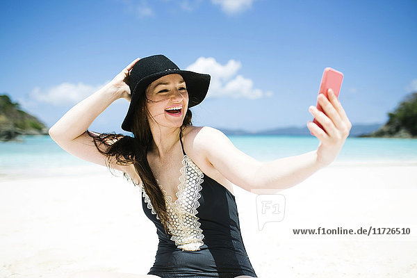 USA  Virgin Islands  Saint Thomas  Woman doing selfie on beach at sunny day