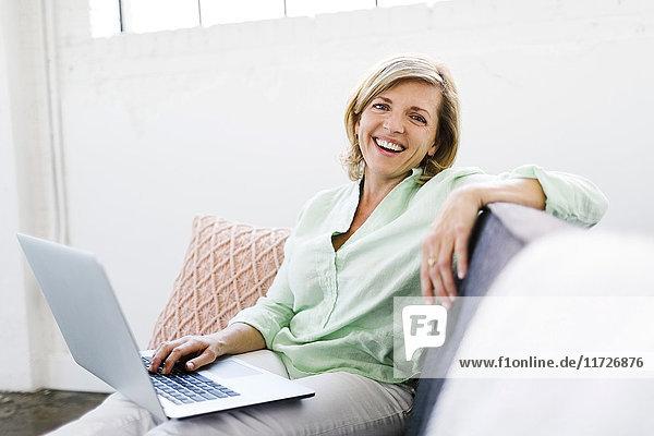 Portrait of Mature woman using computer