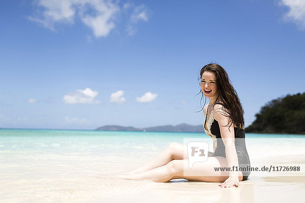 USA  Virgin Islands  Saint Thomas  Beautiful woman sitting on shore