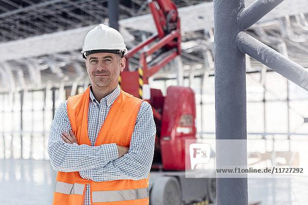 Portrait confident foreman at construction site