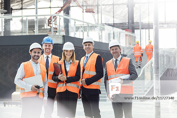 Portrait confident engineers and architects at construction site