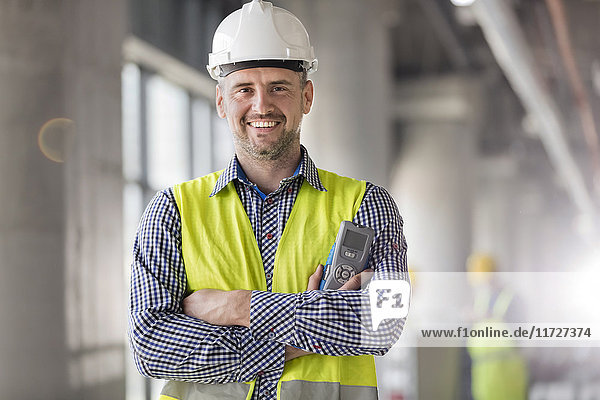 Portrait smiling engineer at construction site