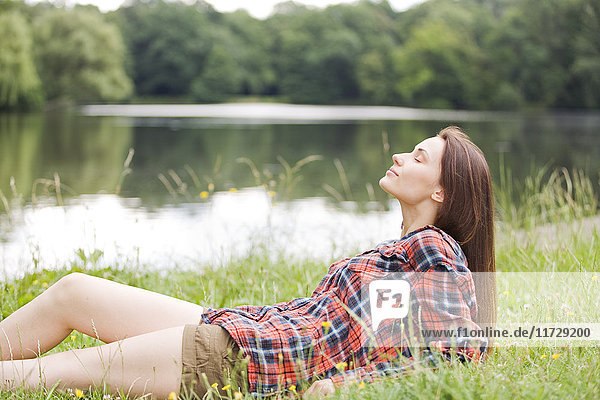 Woman relaxing by a lake