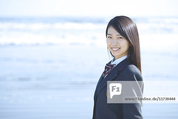 Young Japanese woman in a high school uniform by the sea  Chiba  Japan