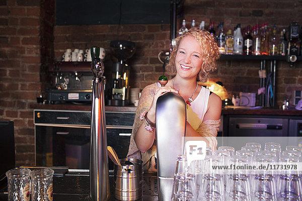 Bartender at bar in club