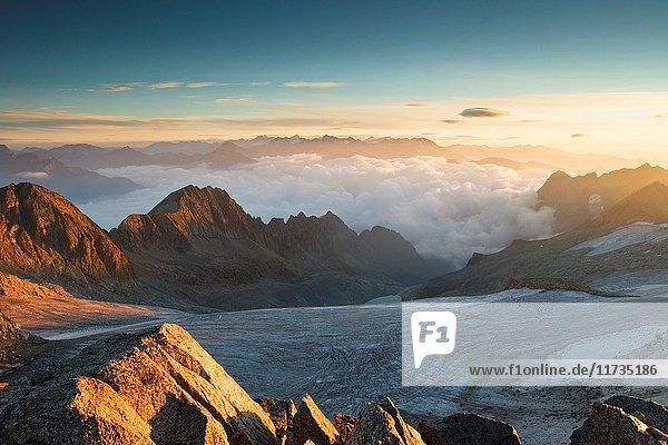 Sunrise from Venerocolo peak  seeing the Pisgana glacier  Lombardy.