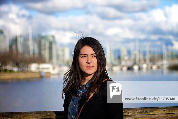 Beautiful young Colombian girl enjoying a sunny day at a beach in Vancouver Canada.