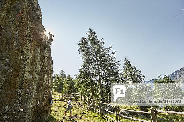 Young rock climbing couple climbing rock formation  Val Senales  South Tyrol  Italy