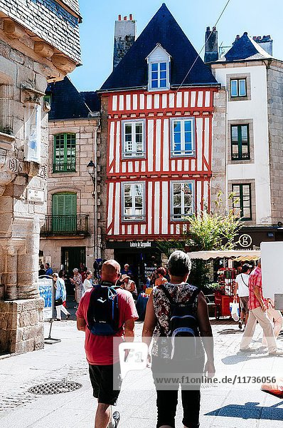 Narrow pedestrian stone streets full of fifteenth-century row houses and tourists. Quimper  Brittany  France.