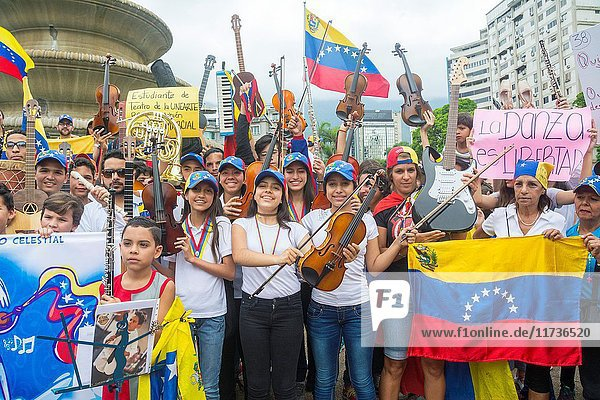 Children musicians congregate in the Francia square of Altamira  in a tribute for the dead in the last protests in Caracas. Musicians and artists marched in homage to the dead in the protests in Caracas. Venezuela. May 7 2017.