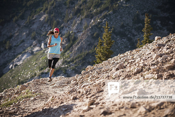 Runner on Catherine's Pass trail  Wasatch Mountains  Utah  USA  Wasatch Mountains  Utah  USA