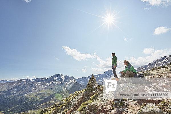 Young hiking couple looking out at Val Senales Glacier  Val Senales  South Tyrol  Italy